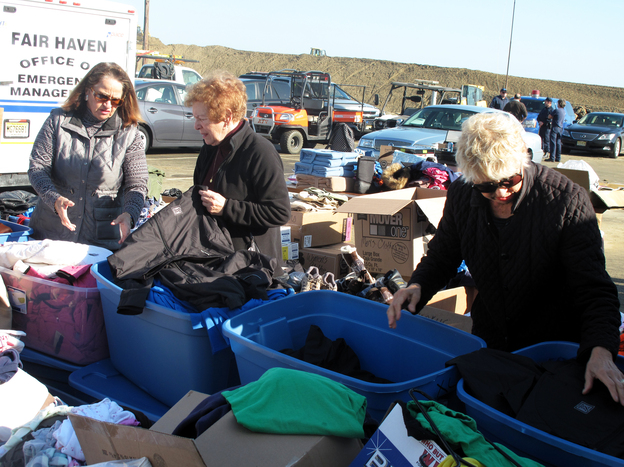 Volunteers sort through donated clothes in Sea Bright, N.J.