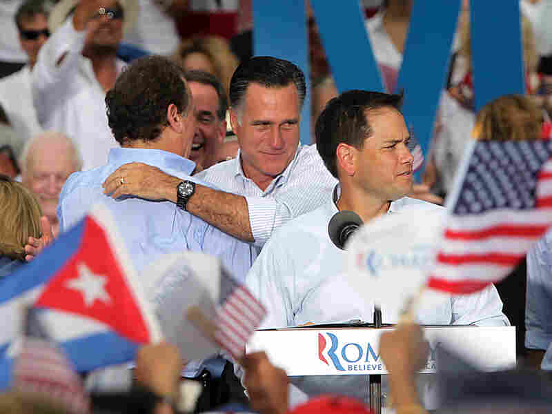 Florida Sen. Marco Rubio (foreground), a Cuban-American, introduces Republican presidential candidate Mitt Romney in Miami on Aug. 13 as Romney embraces former Florida Rep. Lincoln Diaz-Balart, who was born in Havana.