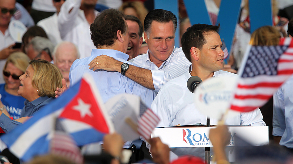 Florida Sen. Marco Rubio (foreground), a Cuban-American, introduces Republican presidential candidate Mitt Romney in Miami on Aug. 13 as Romney embraces former Florida Rep. Lincoln Diaz-Balart, who was born in Havana. (MCT/Landov)