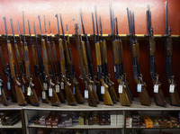 Rifles on display at Firing-Line in Aurora, Colo., on July 22, 2012, days after a shooter killed at least 12 people at a local movie theater.