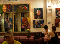 Paintings of Burmese street scenes decorate the walls of Aiya. Patrons who come for the Burmese and Thai food can also find portraits of Che Guevara and Aung San Suu Kyi, and bumper stickers declaring