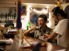 Myat Thu, who owns the Aiya restaurant, takes a break at the bar with his chef Ney Minn. They both grew up in the Burmese capital, Rangoon.