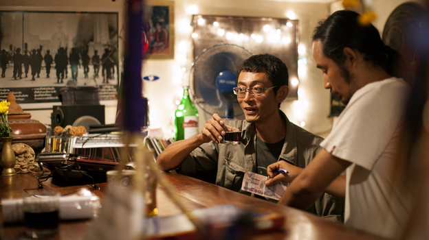 Myat Thu, who owns the Aiya restaurant, takes a break at the bar with his chef Ney Minn. They both grew up in the Burmese capital, Rangoon. (NPR)