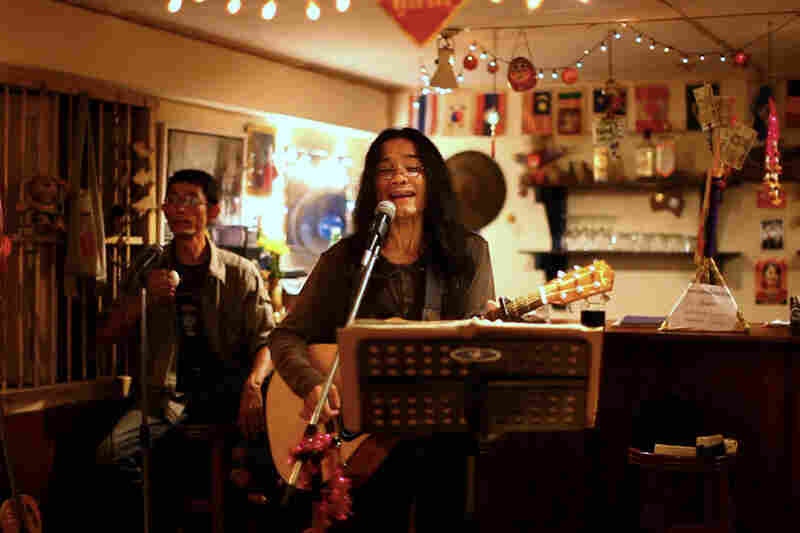 """The restaurant features live music on Friday and Saturday nights. Myat Thu plays percussion during the band's rendition of Bob Dylan's """"Blowin' in the Wind."""""""