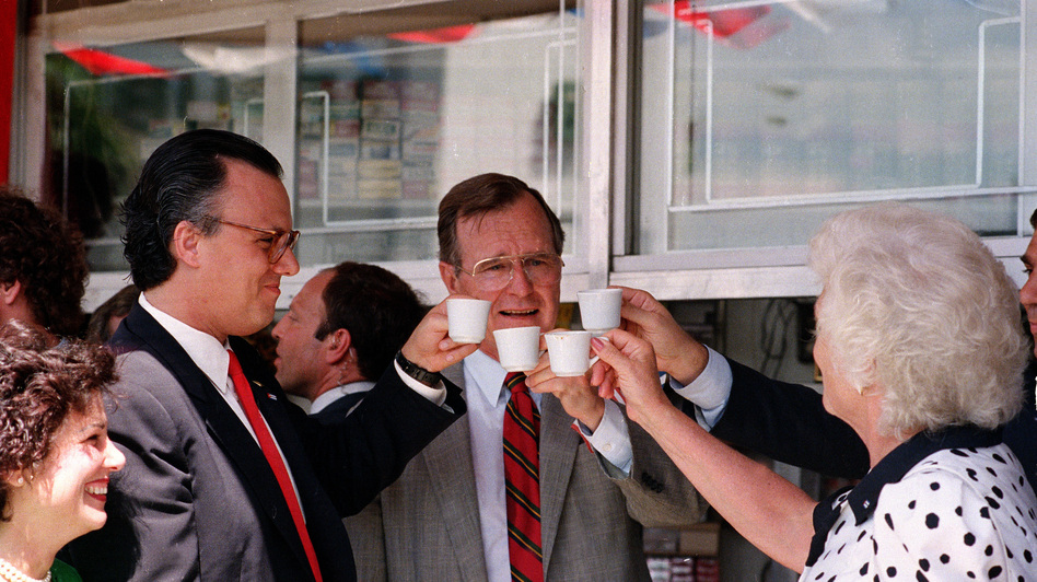 Vice President George H.W. Bush toasts with cups of Cuban coffee on June 17, 1987, in the Little Havana neighborhood of Miami. Bush, who was in Florida to raise funds for his bid for the Republican presidential nomination, stopped at the restaurant after ceremonies renaming a street in the neighborhood for President Reagan. (AP)