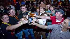 Not surprisingly, men like these guys cheering Sam Adams love beer. But more women than you might expect do too, according to a new study.