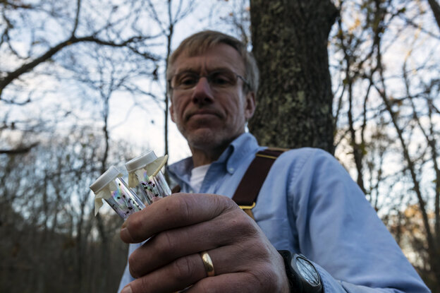 "Last year, Tom Mather caught 15,000 deer ticks in the woods of southern Rhode Island. ""People really need to become tick l"