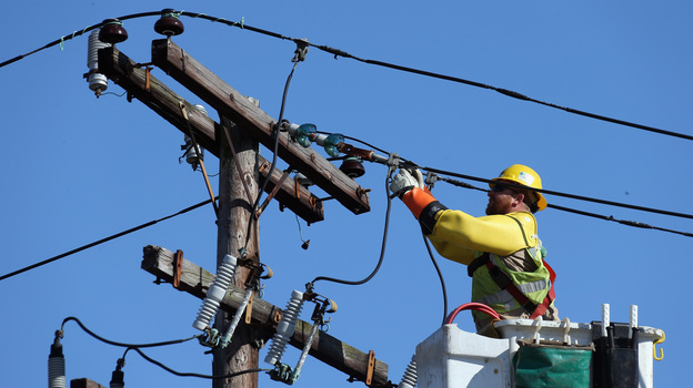 A worker repairs electrical lines as Long Islanders continue their cleanup efforts in the aftermath of Superstorm Sandy in Plainview, N.Y.