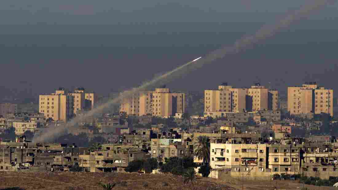 Palestinian militants fire a rocket from the northern Gaza Strip toward s