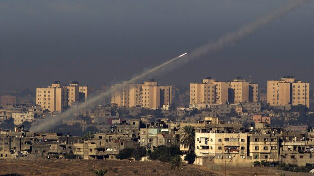 Palestinian militants fire a rocket from the northern Gaza Strip toward southern Israel on Thursday. For the past decade, Palestinians in Gaza have been shooting short-range rockets into southern Israel. But Palestinians fired a much longer range rocket that landed just outside Jerusalem on Friday, a move seen as a major escalation. (EPA /LANDOV)
