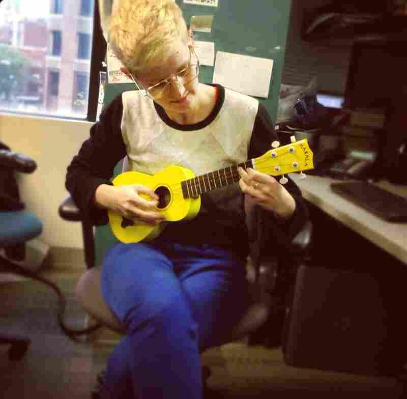 Selena Simmons-Duffin strums a few cords on her ukelele during a light moment of the Sandy coverage.