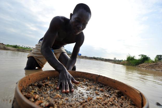 A diamond prospector filters earth from a river in Koidu, the capital of diamond-rich Kono district in eastern Sierra Leone. Koidu suffered some of the worst ravages of Sierra Leone's war in the 1990s as rebels forced citizens to mine at gunpoint. Ten years after the conflict, diamonds remain a contentious issue.
