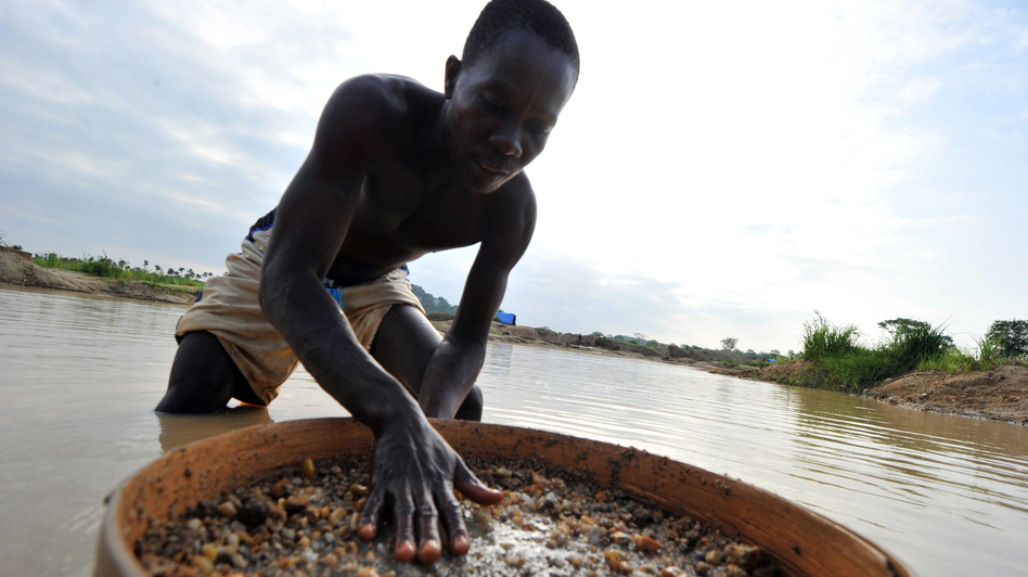 A diamond prospector filters earth from a river in Koidu, the capital of diamond-rich Kono district in eastern Sierra Leone. Koidu suffered some of the worst ravages of Sierra Leone's war in the 1990s as rebels forced citizens to mine at gunpoint. Ten years after the conflict, diamonds remain a contentious issue. (AFP/Getty Images)