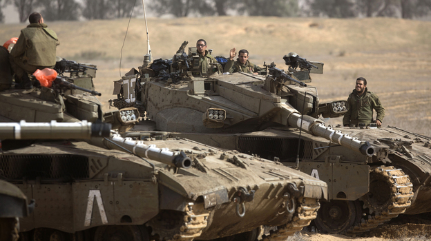 Israeli tanks on the border with the Gaza Strip earlier today. Israeli officials have said they are prepared to mount a ground offensive. (AFP/Getty Images)