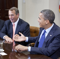 President Obama wishes Speaker John Boehner a happy birthday during a budget meeting at the White House Friday.