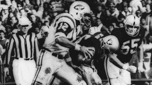 """""""The Heidi Game"""": New York Jets quarterback Joe Namath sweeps around the right side past Oakland defenders Ralph Oliver and Dan Conners to score from the one-yard line during the second quarter against the Oakland Raiders in Oakland on Nov. 17, 1968."""