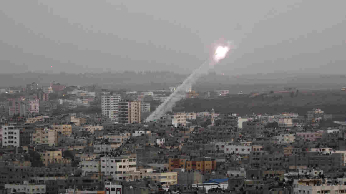 Rockets lunched by Palestinian militants toward Israel make their way from the northern Gaza Strip on Saturday.