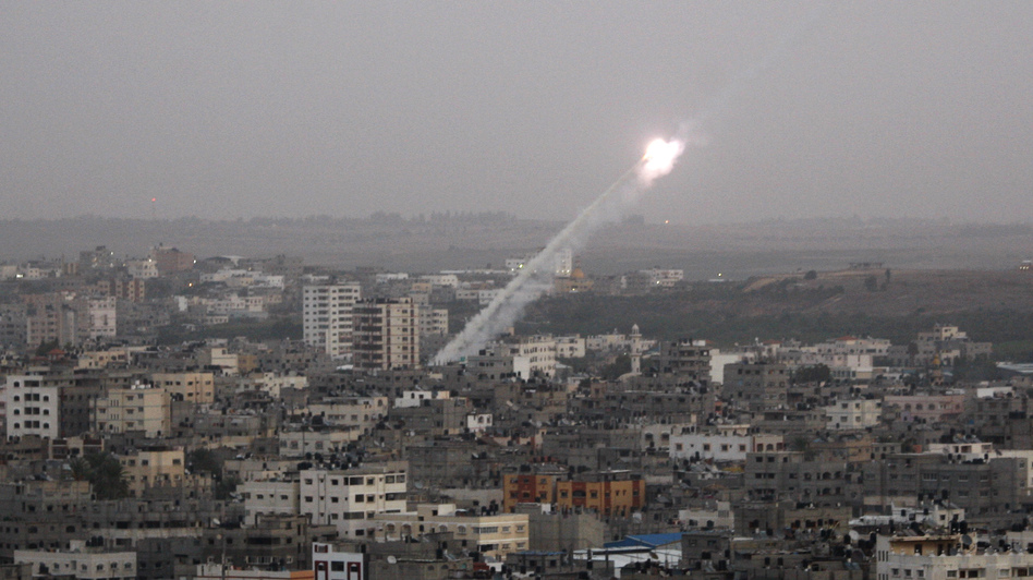 Rockets lunched by Palestinian militants toward Israel make their way from the northern Gaza Strip on Saturday. (AP)