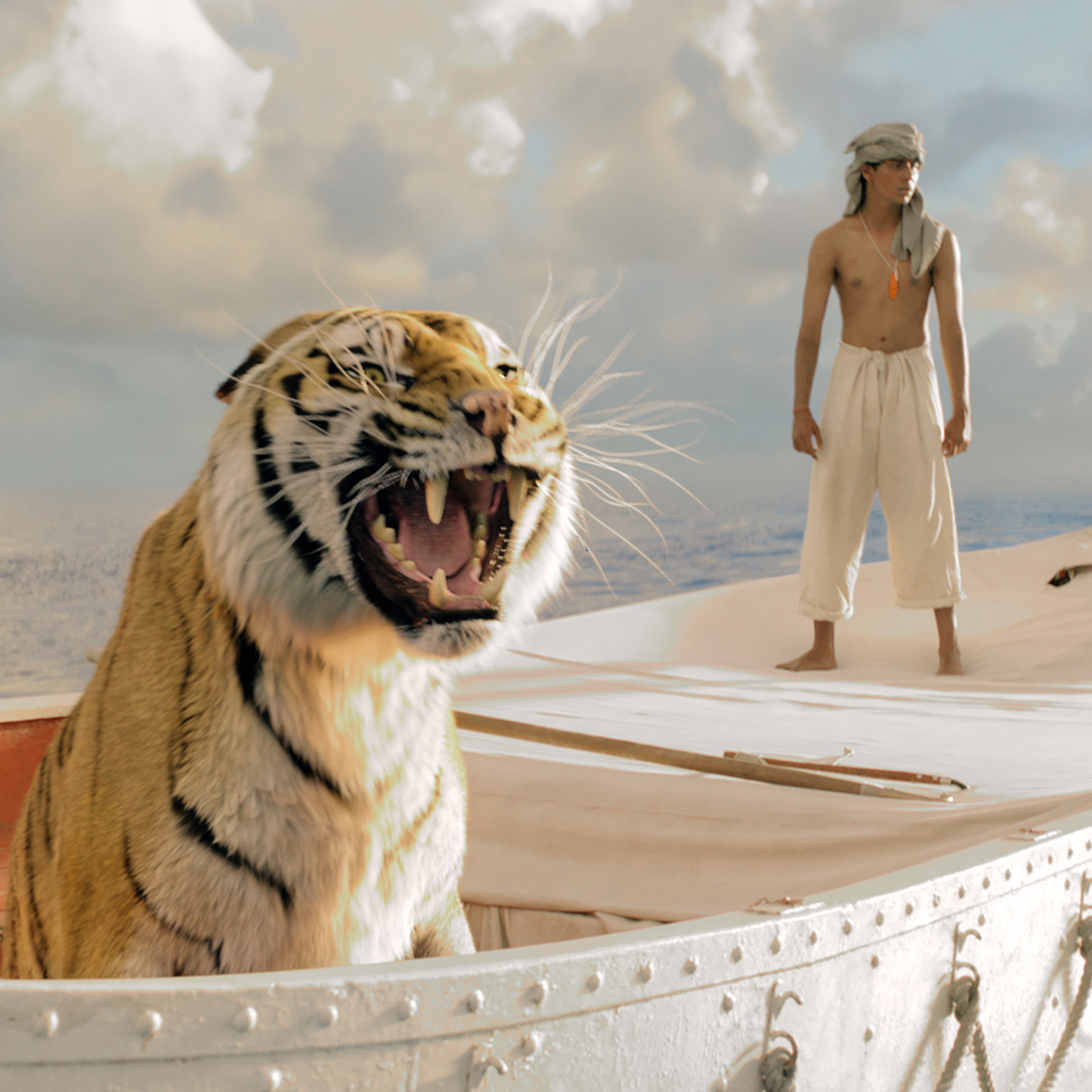 Pi Patel (Suraj Sharma) and a fierce Bengal tiger named Richard Parker must rely on each other to survive an epic journey in Life of Pi.