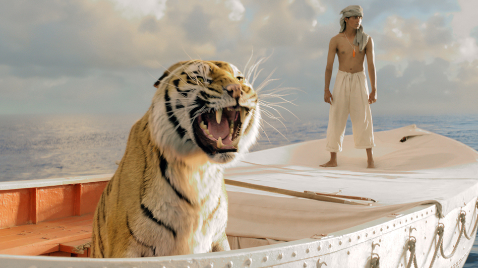 Pi Patel (Suraj Sharma) and a fierce Bengal tiger named Richard Parker must rely on each other to survive an epic journey in Life of Pi. (Twentieth Century Fox)