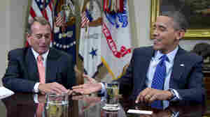 President Obama reaches to shake hands with House Speaker John Boehner, during a meeting Friday at the White House to discuss the deficit and economy.