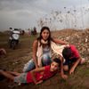 Israeli civilians in Tel Aviv run for cover during a rocket attack launched from Gaza on Saturday.