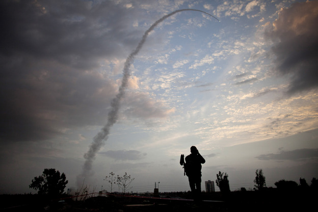 A missile from Israel's Iron Dome defense system launches to intercept and destroy incoming rocket fire from Gaza in Tel Aviv on Saturday.