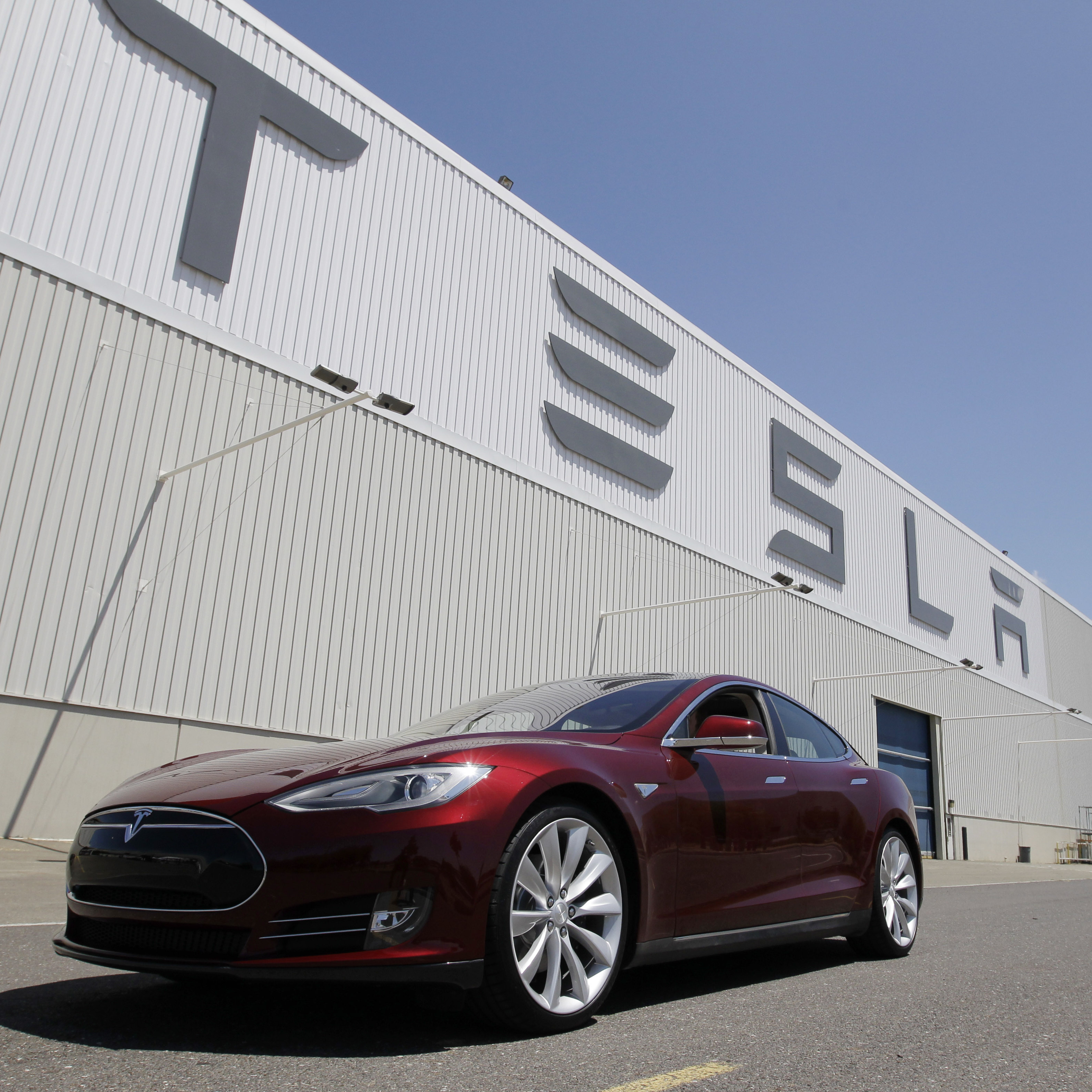 A Tesla Model S drives outside the Tesla factory in Fremont, Calif., on June 22. The electric car was recently named Automobile of the Year by Automobile Magazine and Car of the Year by Motor Trend.