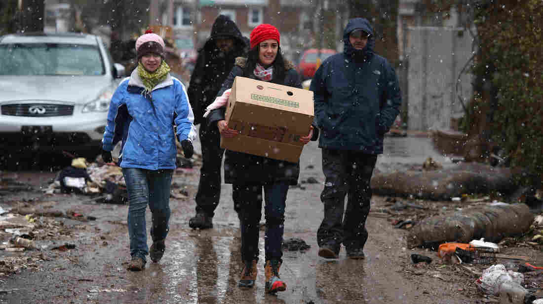 Volunteers bring food to residents of homes damaged by Superstorm Sandy earlier this month in the Staten Island borough of New York City.