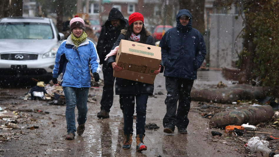 Volunteers bring food to residents of homes damaged by Superstorm Sandy earlier this month in the Staten Island borough of New York City. (Getty Images)
