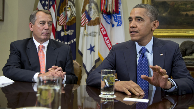 President Obama, accompanied by House Speaker John Boehner of Ohio, speaks to reporters at the White House on Friday during a meeting to discuss the fiscal cliff. (AP)