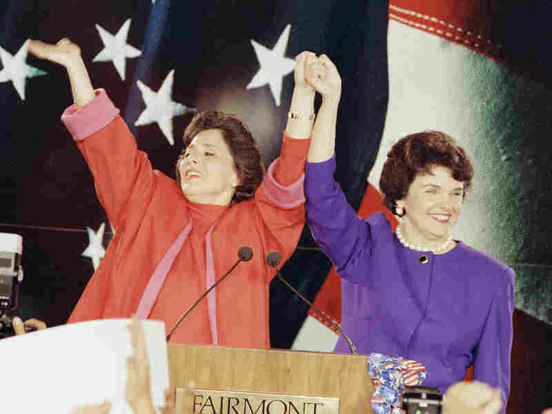 "Democratic Senate candidates Barbara Boxer (left) and Dianne Feinstein raise their arms in victory at an election rally in San Francisco on Nov. 4, 1992, the so-called ""Year of the Woman"" in politics."