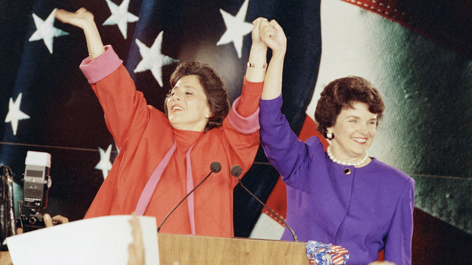 "Democratic Senate candidates Barbara Boxer (left) and Dianne Feinstein raise their arms in victory at an election rally in San Francisco on Nov. 4, 1992, the so-called ""Year of the Woman"" in politics. (AP)"