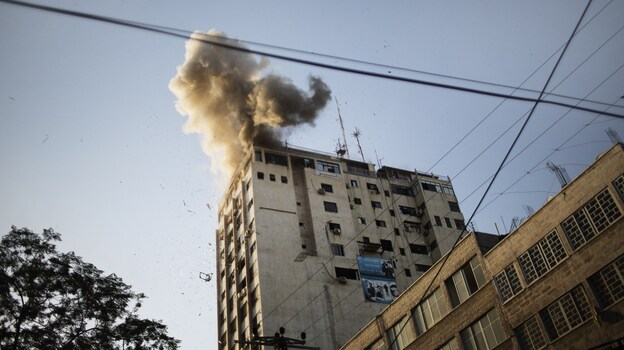Smoke billows from the local Al-Aqsa TV station in Gaza City Sunday after an Israeli airstrike. (AFP/Getty Images)
