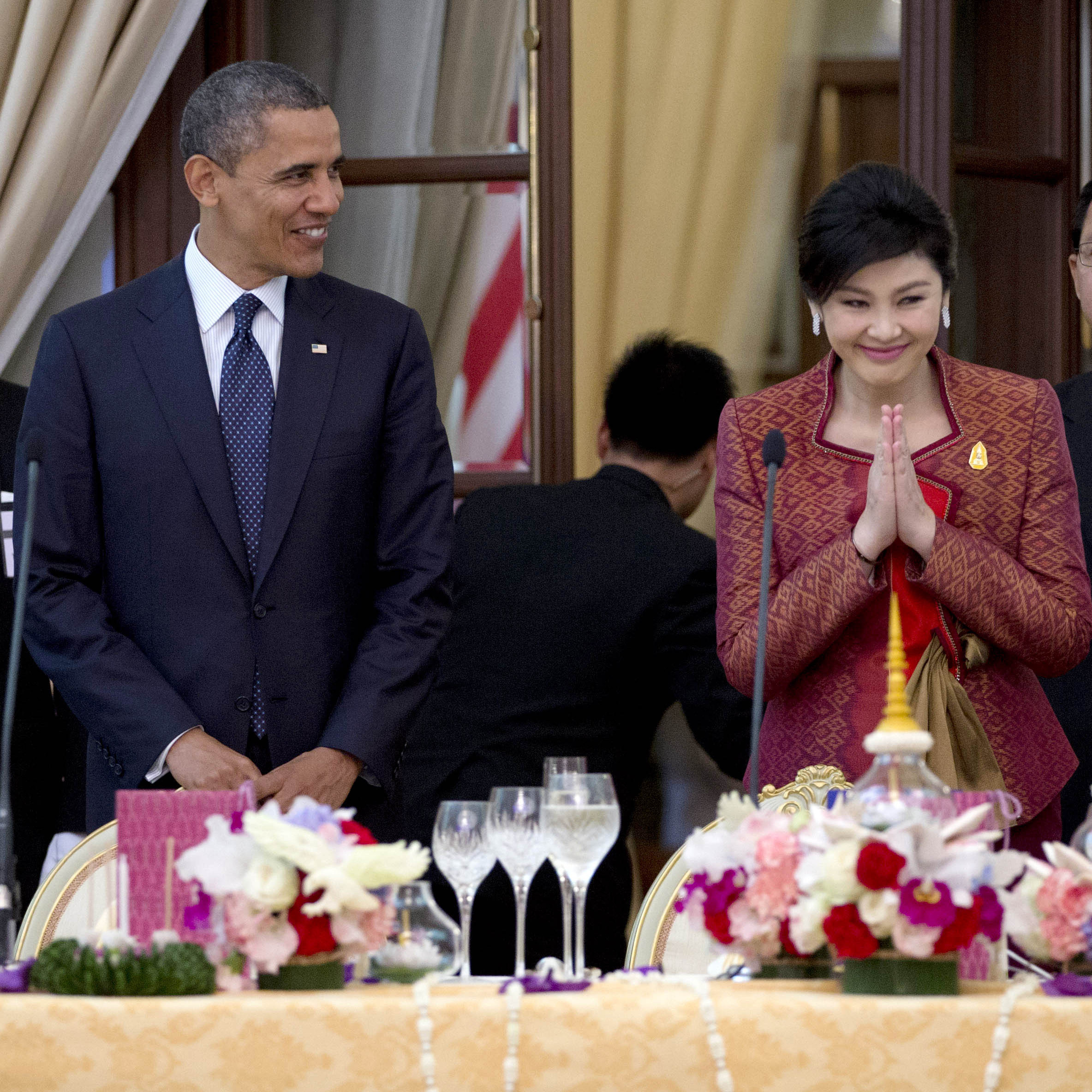 President Obama and Thai Prime Minister Yingluck Shinawatra (second from right) arrived for an official dinner Sunday at Government House in Bangkok, Thailand.