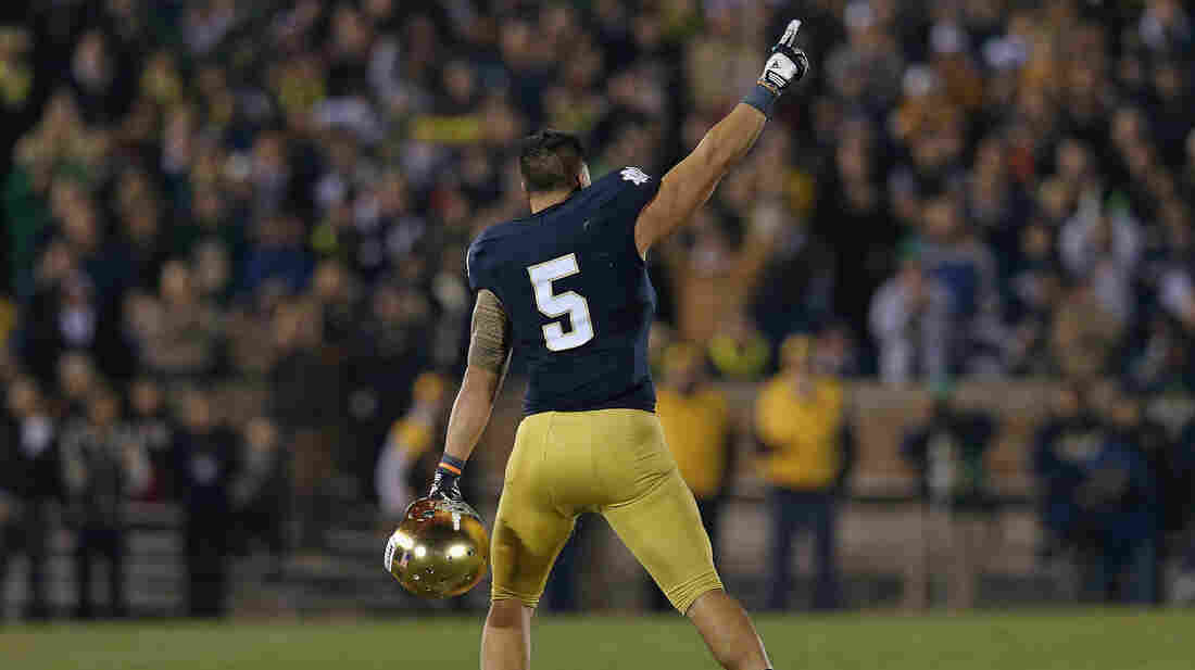 Manti T'eo #5 of the Notre Dame Fighting Irish waves to the crowd as he leaves the home field for the last time after a 38-0 win against the Wake Forest Demon Deacons.
