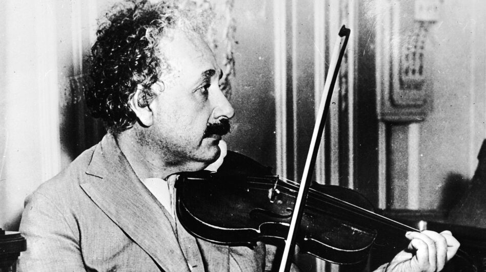 Albert Einstein, seen playing the violin in the music room of the S.S. Belgenland, had knoblike structures on the part of the brain that controls motion of the right hand. Brain scans of modern musicians show similar structures. (Getty Images)