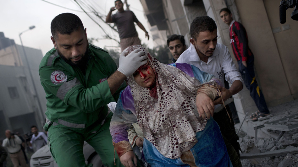 The Israelis and Palestinians have clashed repeatedly over the Gaza Strip, but the recent upheavals in the Middle East have changed the dynamics this time. Here, a Palestinian woman is helped after being injured in an Israeli strike in Gaza City on Monday. (AP)