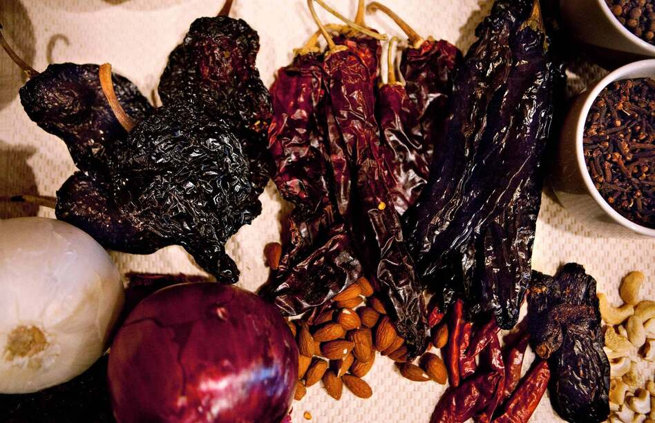 The main ingredient in mole is dried chili peppers; to prepare them for cooking, one must remove the seeds, toast the seeds with tortillas, then rinse the seeds, then roast the skins, rehydrate them and finally blend and cook them together with all the other ingredients.