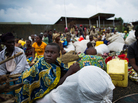 Fleeing the fighting: Internally displaced Congolese sit inside a United Nations base in Monigi, near Goma, as they seek shelter from the violence.