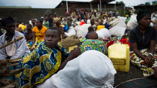Fleeing the fighting: Internally displaced Congolese sit inside a United Nations base in Monigi, near Goma, as they seek shelter from the violence. (AFP/Getty Images)