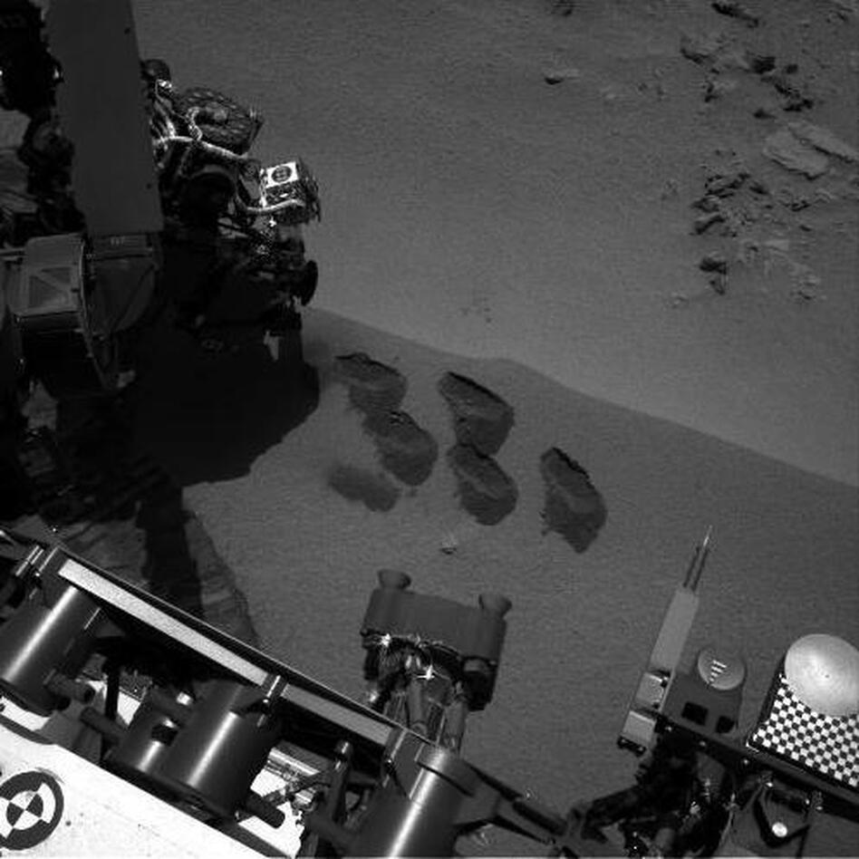 "NASA's Mars rover Curiosity dug up five scoops of sand from a patch nicknamed ""Rocknest."" A suite of instruments called SAM analyzed Martian soil samples, but the findings have not yet been released. (NASA/JPL-Caltech)"