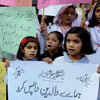 Students demand the reopening of the Farooqi Girls High School in Lahore, Pakistan, in early November. A mob attacked the school in October, accusing a teacher of insulting the Prophet Muhammad. It takes just one accusation to lead to an arrest under Pakistan's stringent blasphemy laws.