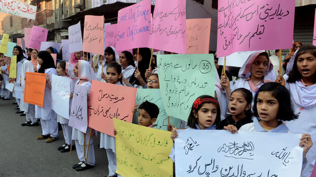 Students demand the reopening of the Farooqi Girls High School in Lahore, Pakistan, in early November. A mob attacked the school in October, accusing a teacher of insulting the Prophet Muhammad. It takes just one accusation to lead to an arrest under Pakistan's stringent blasphemy laws. (AFP/Getty Images)