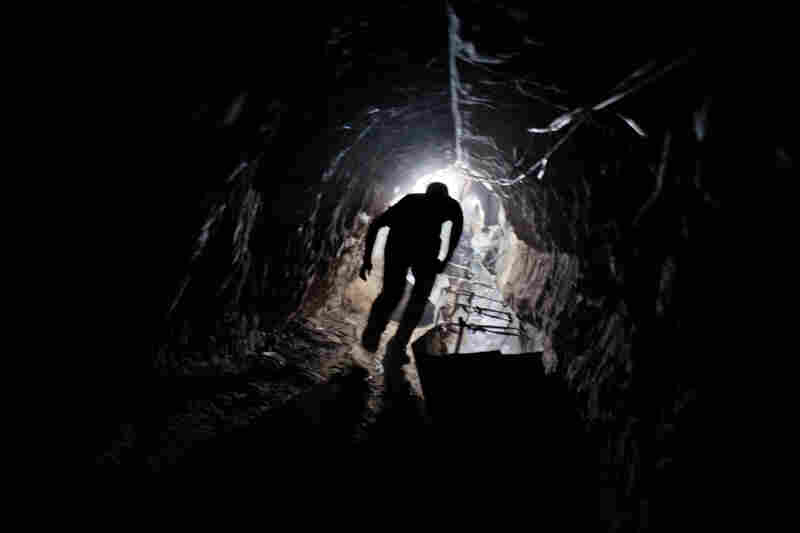 A worker emerges from one of hundreds of smuggling tunnels that connect the Gaza Strip and Egypt.