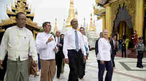 President Obama (center) and U.S. Secretary of State Hillary Clinton (right) toured the Shwedagon Pagoda in Yangon, Myanmar, on Monday.