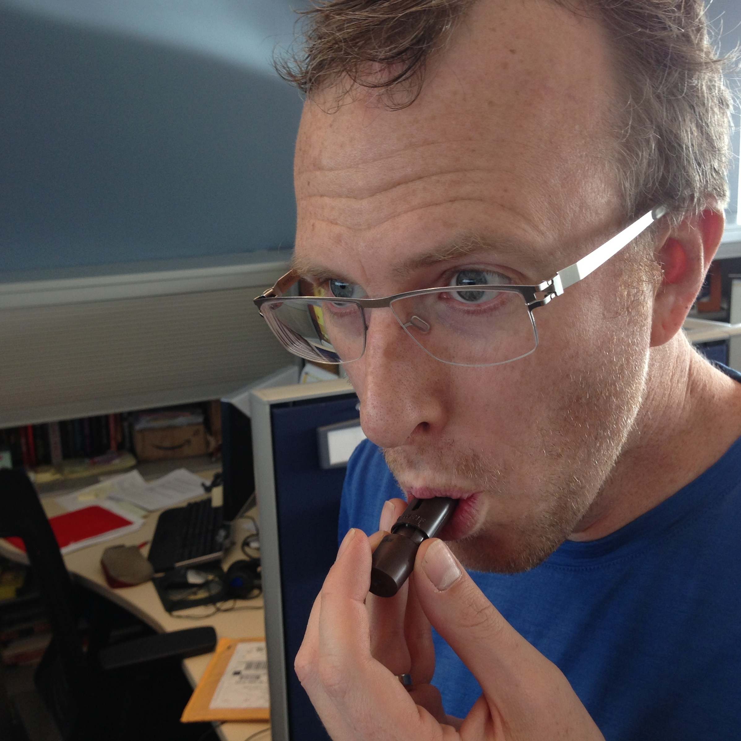 Mike: inhaling chocolate or playing a tiny flute?