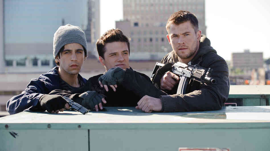 From left: Matt Eckert (Josh Peck) and his friend Robert (Josh Hutcherson) join Matt's Marine brother Jed (Chris Hemsworth) on a mission to stop North Korean invaders.