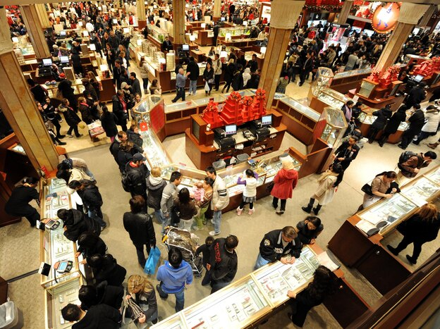 People crowd the aisles inside Macy's department store Nov. 25, 2011, in New York after the midnight opening to begin the