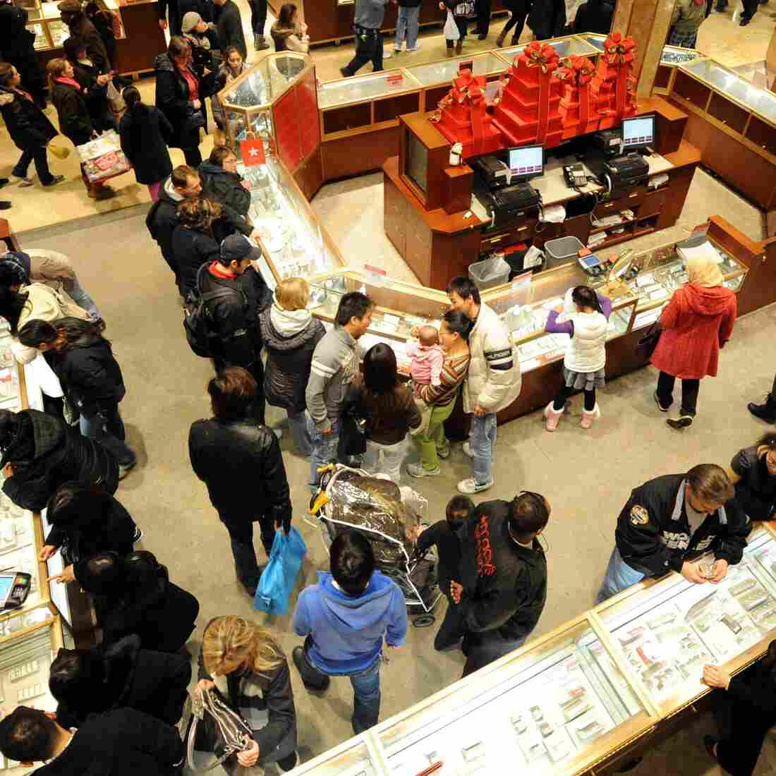 "People crowd the aisles inside Macy's department store Nov. 25, 2011, in New York after the midnight opening to begin the ""Black Friday"" shopping weekend."